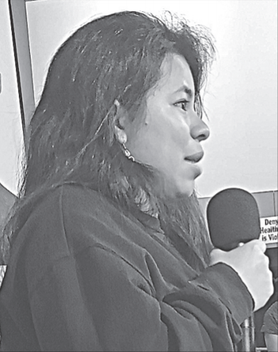 Photograph of Abbie Arevalo Herrera, a young Hondoran woman, speaking into a microphone.